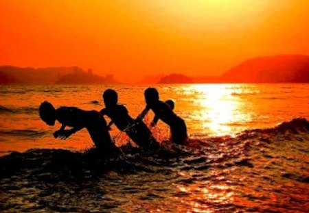 Play at Sunset - swim, creative, shadow, silhouette, coast, friends, brothers, beach, 3, photography, sunset, sons, three