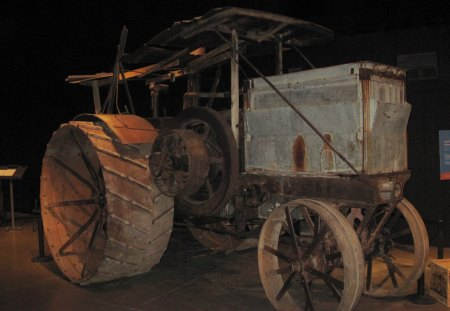 1912 old tractor at the museum - water tank, wheels, iron, tractor