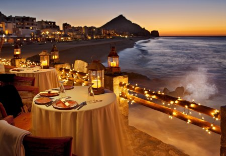Romantic dinner at sunset - evening, glow, beautiful, pretty, twilight, romantic, exotic, beach, water, nice, sunsetm night, dinner, sky, shore, lights, coast, waves, lovely, table, island, village, drink, nature, sea, ocean, dusk, breeze