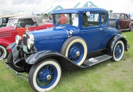 1929 Ford 2 doors sedan at car show - Ford, Photography, white, Headlights, wheels, blue