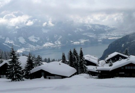 beautiful mountain village in switzerland - lake, mountain, winter, village