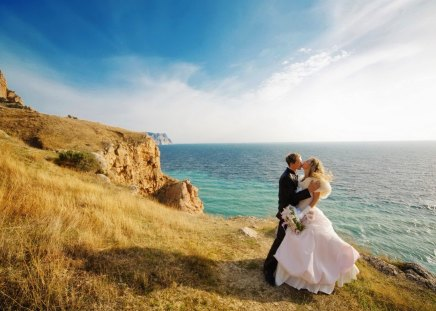 Just married - grass, ocean, bride, wife, waves, just, coast, woman, couple, married, passion, sea, love, rocks, sunrise, sky, water, summer, man, husband, bright, clouds, wedding, shore