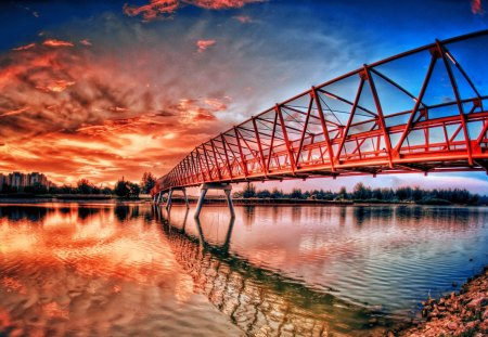 Beautiful bridge over the river - glow, beautiful, orange, river, reflection, pretty, bright, nice, calm, red, summer, riverbank, colorful, sky, dazzling, colors, lovely, town, clouds, bridge, nature, city