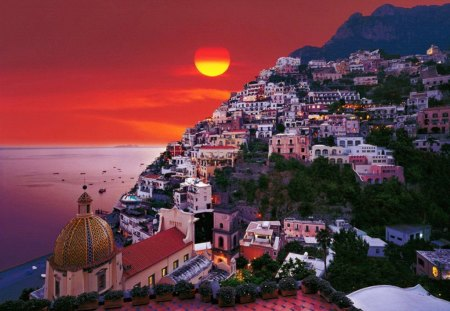 Pozitano - town, red, sun, amazing, fiery, sea, sunrise, fire, sunset, sky, water, nice, houses, pozitano, reflection, lovely, italy, sundown, clouds, pretty, village, cascades