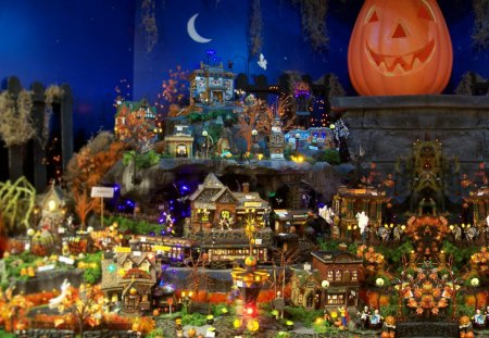 A Halloween Village - m00n, halloween, train, nightime, spiderwebs, autumn, night, trick or treating, spooky, figurines, candles, trees, frankenmuth, ghosts, pumpkins, fall, christmas store, spiders, witches, bronners, nighttime, lights, houses, Ha11oween, october, michigan, pond, ornaments, children, town, spooks, fence, moon, village, crescent, miniatures, families, jack-o-lanterns