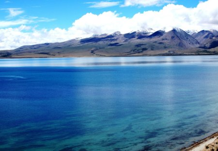 Lake Manasarovar and the Tibetan Himalayas. - lake, himalayas, blue, water, tibet, buddhists, purity, india, mountains, 108, pilgrimage, lake kailash, hindu, mansarovar, spiritual, relegious, holy