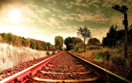 railroad tracks in a bright autumn day - tracks, railroad, trees, clouds, sun, autumn