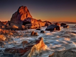 gorgeous seashore with smooth rocks at sunset