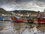 boats at low tide in a seaside british town