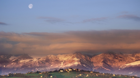 moonset over tuscan landscape - moon, clouds, fields, village, mountain