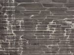 Black small tile wall with streaks