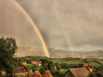 amazing rainbow over rural village