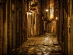 beautiful stone alley in venice at night