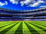 monumental yankee stadium on a clear summer day