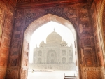 the taj mahal through an eleborate portal
