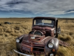 rusted gmc pickup on the prairie hdr