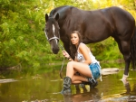 COWGIRL LEADING HORSE TO WATER
