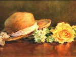 hat and yellow rose