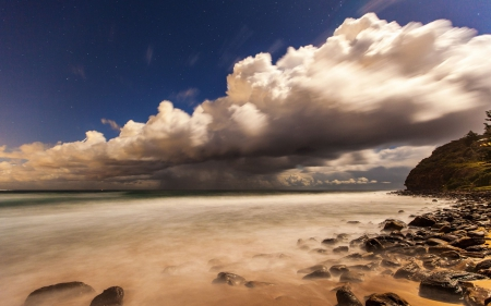 stars above heavy clouds over seashore - sea, clouds, stars, rocks, shore