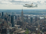 shuttle riding piggyback over nyc