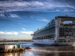 massive cruise ship sailing off hdr