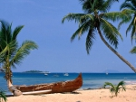 Outrigger Canoe on a Tropical Beach