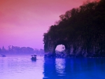 arched cliff on a river in china at dusk