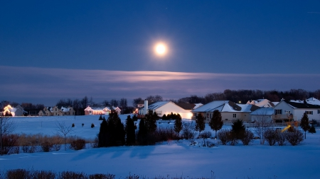 december moon over suburban landscape in winter