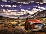 a rusted GMC pickup abandoned in a desert hdr