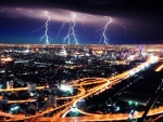 lightning storm over a city at night