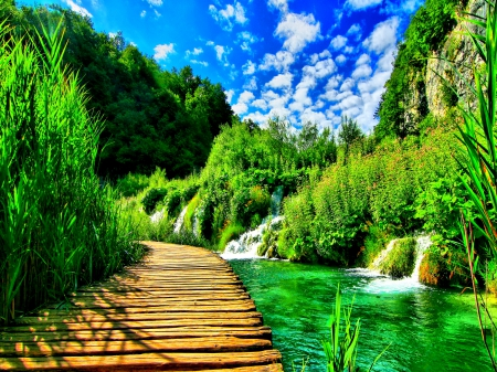 Enchanting Nature - splendor, forest waterfall, path, paradise, forest nature, clouds, wild, beautiful places, bridge, stunning nature, nature, mountains, water streams, blue sky