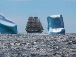 magnificent tall ship among icebergs in north sea