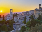 wonderful hillside town of assisi italy at sunset