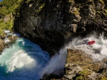 kayaking over extreme river rapids