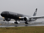 air new zealand 777 on rainy day