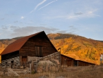 Old Barn in Autumn Landscape