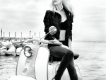 Claudia Schiffer and her Vespa