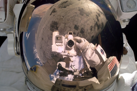 Astronaut Stephen Robinson repairs damage to Space Shuttle - Astronaut, Space Shuttle, Camera, Repair