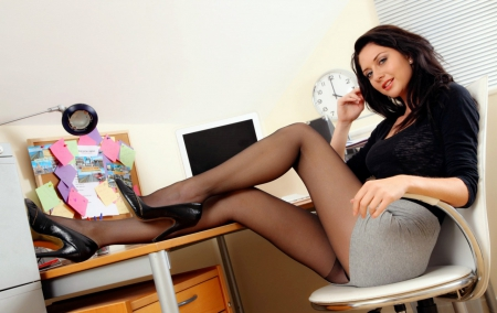 Female office manager in pantyhose