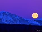 Full Moon over Snow-covered Mountain
