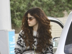 Selena Gomez sporting heart sunglasses