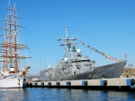 Tall Ship beside a Military Ship