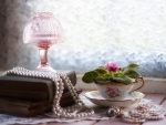 Still life with cup and pearls