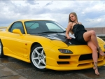 Blonde Model on a Mazda RX 7