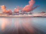 gorgeous pink clouds over sea