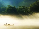 lone boat on a misty river at dawn