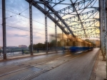 tram on a bridge in long exposure hdr