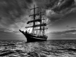 tall ship at sea in grayscale
