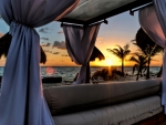 canopy bed on a cancun beach at sunset hdr