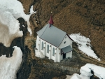 little white chapel on a cliff